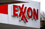 This April 29, 2014 photo shows an Exxon sign at an Exxon gas station in Carnegie, Pa. Gene J. Puskar/AP