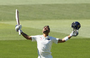 Virat Kohli of India celebrates after reaching his century during day five of the First Test.