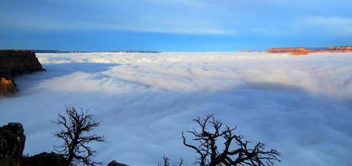"A rare weather phenomenon called ""temperature inversion"" or ""total cloud inversion"" filled the Grand Canyon in Arizona, USA with a sea of dense fog giving an impression of a cloud hanging over the valley on December 11, 2014."
