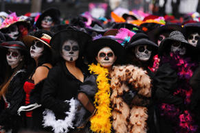 "Women, with faces painted to look like the popular Mexican figure called ""Catrina"", take part in a world record attempt in downtown Mexico City November 1, 2014."