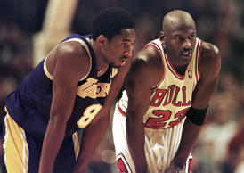 ago Bulls guard Michael Jordan(R) talk during a free-throw attempt during the fo...