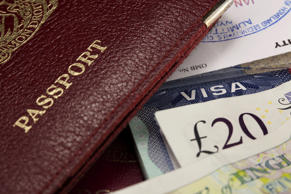Travel background showing passport and UK currency.