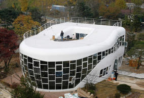 A lavatory-shaped house, Haewoojae, which means the house for satisfying one's anxiety in Suwon. South Korean sanitation activists marked the start of a global toilet association by lifting the lid on the world's first lavatory-shaped home that offers plenty of water closet space.