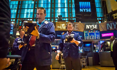 Traders work at the New York Stock Exchange during early trading, Monday, Dec. 15, 2014, in New York