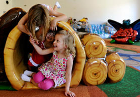 Young girls play with their friends at a daycare center in Denver, Colorado.