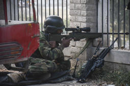 File: PESHAWAR, PAKISTAN - DECEMBER 16:  Pakistani soldier takes position near the site of an attack by Taliban gunmen on a school in the northwestern city of Peshawar, Pakistan, on December 16, 2014. Taliban attack on an army-run school in Pakistan on Tuesday has left at least 100 people dead, most of them students.