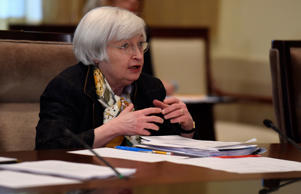 Federal Reserve Chair Janet Yellen attends the Board of Governors of the Federal Reserve System open meeting at the Federal Reserve Building in Washington, Tuesday, Dec. 9, 2014.