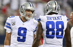 Dallas Cowboys quarterback Tony Romo (9) talks with wide receiver Dez Bryant (88) before the game against the San Francisco 49ers at AT&T Stadium on Sept. 7, 2014 in Arlington, Texas.