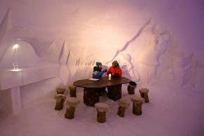 Guest sit inside the lobby of the igloo hotel, operated by Iglu-Dorf, on the Parsenn Mountain, in the town of Davos, Switzerland, on Jan. 21, 2014.