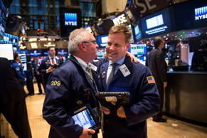 Traders work on the floor of the New York Stock Exchange during the afternoon of December 17, 2014 in New York City. Stocks rose nearly 300 points, marking the best day for the Dow Jones Industrial Average of 2014, after the Federal Reserve announced it plans to begin raising interest rates next year.