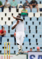 West Indies's bowler Kemar Roach bowls, on  day 1 of the 1st test cricket match between South Africa and the West Indies,  at Centurion Park in Pretoria, South Africa, Wednesday, Dec. 17, 2014.