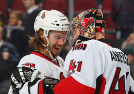 Winning Goaltender Craig Anderson #41 of the Ottawa Senators is congratulated by teammate Mike Hoffman #68 after shutting out the New Jersey Devils at the Prudential Center on December 17, 2014 in Newark, New Jersey. The Senators defeated the Devils 2-0.