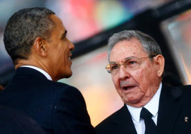 File: U.S. President Barack Obama (L) greets Cuba's President Raul Castro before giving his speech at the memorial service for late South African President Nelson Mandela in Johannesburg in this December 10, 2013 file photo.
