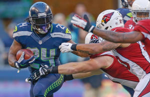 Running back Marshawn Lynch #24 of the Seattle Seahawks rushes against the Arizona Cardinals at CenturyLink Field on November 23, 2014 in Seattle, Washington.