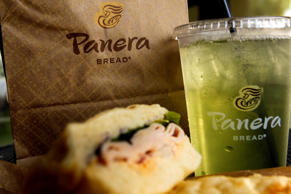 The Panera Bread Co. logo is seen on an ice tea, bag and turkey sandwich displayed for a photograph at a Panera Bread Co. store in Torrance, California, U.S, on Monday, Oct. 21, 2013.