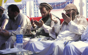 An alleged plotter of Mumbai attacks, Pakistani Zaki-ur-Rehman Lakhvi, center, prays with Syed Salahuddin, right, chief of Hezbul Mujahedeen, or United Jehad Council, at a rally on Saturday, June 28, 2008, in Muzaffarabad, capital of Pakistani Kashmir.