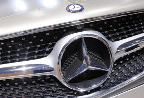A Mercedes-Benz logo is seen on a car displayed on media day at the Paris Mondial de l'Automobile, October 2, 2014.