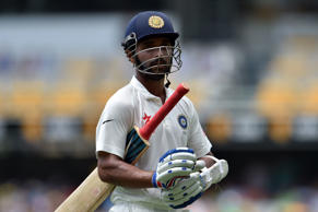 India's batsman Ajinkya Rahane (C) walks off the field following his dismissal on the second day of the 2nd Test match between Australia and India at The Gabba in Brisbane on December 18, 2014.