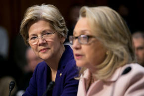 Senator Elizabeth Warren, a Democrat from Massachusetts, left, looks on as U.S. Secretary of State Hillary Clinton speaks during a Senate Foreign Relations Committee nomination hearing in Washington, D.C., U.S., on Thursday, Jan. 24, 2013.