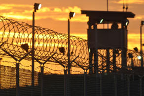 A guard watches over Camp Delta in the Guantanamo Bay detention center in Oct 24, 2010.