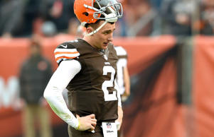 Quarterback Johnny Manziel #2 of the Cleveland Browns reacts as he walks off the field during the first half against the Cincinnati Bengals  at FirstEnergy Stadium on December 14, 2014 in Cleveland, Ohio.