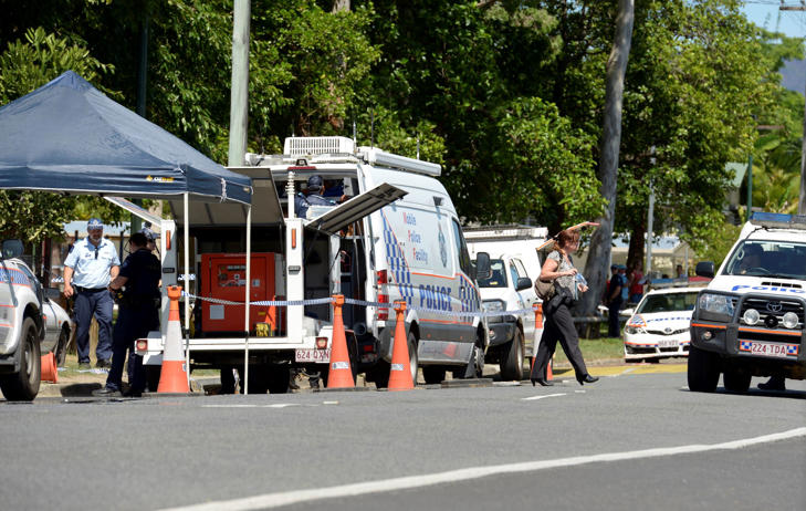 Police block the road outside a house where eight children have been found dead in a suburb of Cairns in far north Queensland, Australia, Dec. 19, 2014.