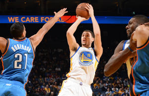 Klay Thompson of the Golden State Warriors takes a shot against the Oklahoma City Thunder on Dec. 18 in Oakland, Calif.