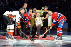 Saku Koivu during pre-game ceremony being held in his honour, with his family members and the captains Andrei Markov #79 of the Montreal Canadiens and Ryan Getzlaf #15 of the Anaheim Ducks at the Bell Centre on December 18, 2014 in Montreal, Quebec, Canada.