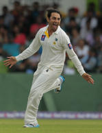 Pakistan's bowler Saeed Ajmal celebrates the dismissal of Sri Lankan batsman Lahiru Thirimanne during the fourth day of the second test cricket match between Sri Lanka and Pakistan in Colombo, Sri Lanka, Sunday, Aug. 17, 2014.