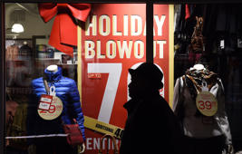 Shoppers gather for the start of the holiday shopping season in National Harbor, Md., on Thanksgiving night.