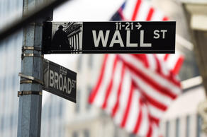 A Wall Street road sign is pictured near the New York Stock Exchange (NYSE) building.