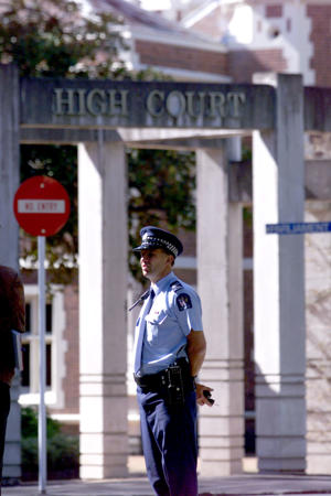 A Policeman standing outside the Auckland High Court.