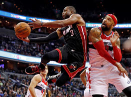 Miami Heat guard Dwyane Wade shoots as he drives past Washington Wizards forward Drew Gooden, right, in the first half of an NBA basketball game on Monday in Washington. Alex Brandon/AP