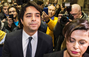 Canadian celebrity radio host Jian Ghomeshi leaves court with his legal team after getting bail on multiple counts of sexual assault in Toronto November 26, 2014. Ghomeshi, 47, former host of the internationally syndicated music and arts program Q on Canadian Broadcasting Corp radio, surrendered to police and was charged with four counts of sexual assault and one of choking, Toronto police said.