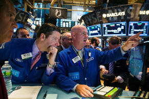Traders work on the floor of the New York Stock Exchange shortly after the markets open in New York November 7, 2014.