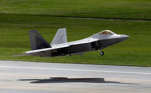 A U.S. Air Force Stealth fighter F-22 Raptor takes off from an air base in Okinawa, Japan.