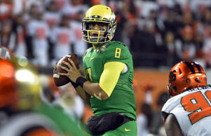 Quarterback Marcus Mariota #8 of the Oregon Ducks passes the ball during the fourth quarter of the game against the Oregon State Beavers at Reser Stadium on November 29, 2014 in Corvallis, Oregon.