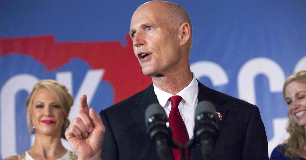 Florida Governor Rick Scott signs gun-safety bill into law, following Parkland School shooting.