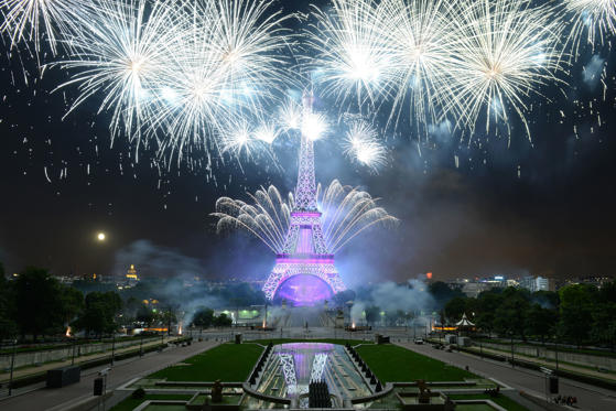 Fireworks explode around the Eiffel Tower during the annual Bastille Day celebrations on July 14, 2014 in Paris, France. The French National Day, commemorates the beginning of the French Revolution with the storming of the Bastille fortress and prison on July 14, 1789.