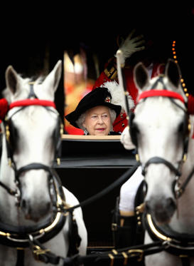 Queen Elizabeth II travels by carriage after the Most Noble Order of the Garter Ceremony on June in Windsor, England. The Order of the Garter is the senior and oldest British Order of Chivalry, founded by Edward III in 1348. Membership in the order is limited to the sovereign, the Prince of Wales, and no more than twenty-four members.
