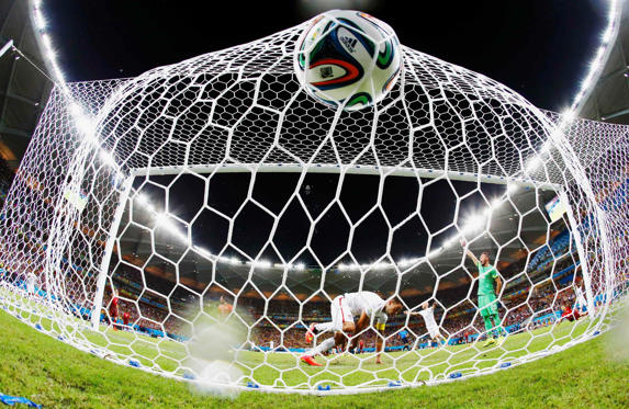 Clint Dempsey, centre, of the US knocks the ball into the net to score against Portugal during their 2014 World Cup Group G soccer match at the Amazonia arena in Manaus June 22.