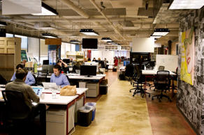 Employees of start-up companies work at their designated spaces at the offices of 1776 business incubator in Washington DC, February 11, 2014.