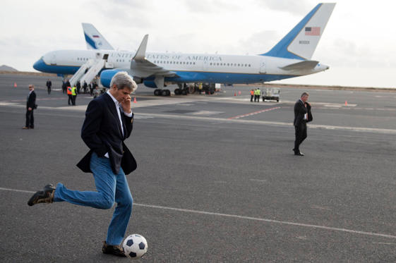 US Secretary of State John Kerry kicks a soccer ball around during an airplane refuelling stop at Sal Island, Cape Verde, enroute to Washington, DC on May 5.