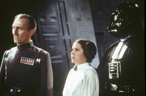 Peter Cushing (l), Carrie Fisher and Darth Vader in 'Star Wars'