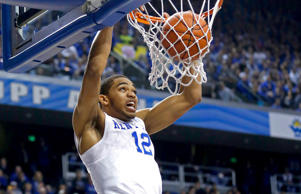 Kentucky Wildcats forward Karl-Anthony Towns dunks the ball against the Eastern Kentucky Colonels during a game on Dec. 7, 2014, in Lexington, Ky.
