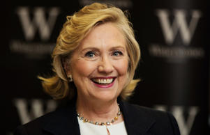 "Former U.S. Secretary of State Hillary Clinton smiles during a book signing for her book ""Hard Choices"" at a Waterstones book store in London July 3, 2014."