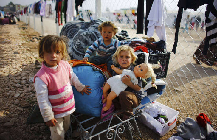 Kurdish refugee girls from the Syrian town of Kobani play in a refugee camp in the Turkish border town of Suruc, Sanliurfa.