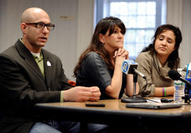 Jeremy Richman, left, and his wife Jennifer Hensel, center, parents of Sandy Hook Elementary school shooting victim Avielle Richman, and Nelba Marquez-Greene, right, mother of victim Ana Marquez-Greene address the Sandy Hook Advisory Commission, Friday, Nov. 14, 2014, in Newtown, Conn. Jessica Hill/AP