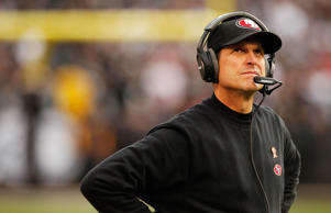 Dec 7, 2014; Oakland, CA, USA; San Francisco 49ers head coach Jim Harbaugh looks towards the scoreboard during a break in the action against the Oakland Raiders in the fourth quarter at O.co Coliseum. The Raiders defeated the 49ers 24-13.