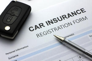 Car insurance forms and car key.